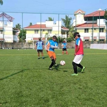 Blind footballer Anthony Samuel kicking the ball towards an opponent in a training activity